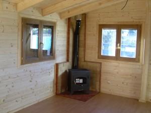 Instalar una estufa en una casa de madera