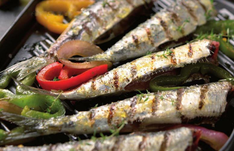 Vista de unas sabrosas sardinas a la parilla